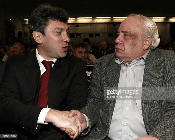 Leader of the Union of Right Forces party Boris Nemtsov shakes hands with Sovietera Dissident Vladimir Bukovsky at an opposition meeting in Moscow 17...
