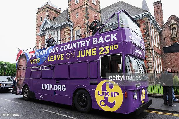 Leader of the United Kingdom Independence Party Nigel Farage addresses supporter from his battle bus as he campaigns for votes to leave the European...