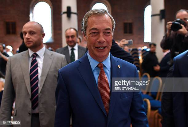 Leader of the United Kingdom Independence Party Nigel Farage leaves the platform after making a speech in London on July 4 announcing that he was...