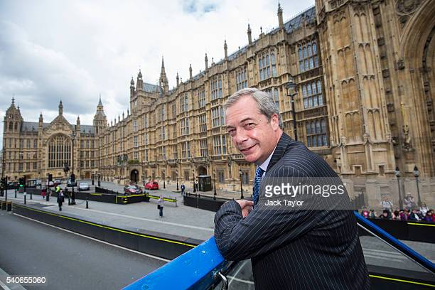 Leader of the United Kingdom Independence Party Nigel Farage poses on his campaign bus as it passes the Houses of Parliament during the launch of the...