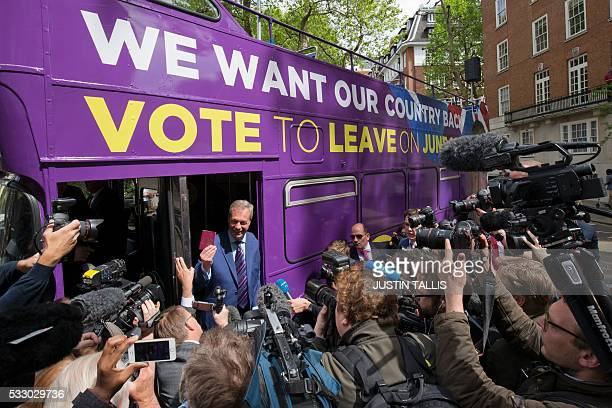 Leader of the United Kingdom Independence Party Nigel Farage poses for photographers holding a British passport at the launch of the party's opentop...