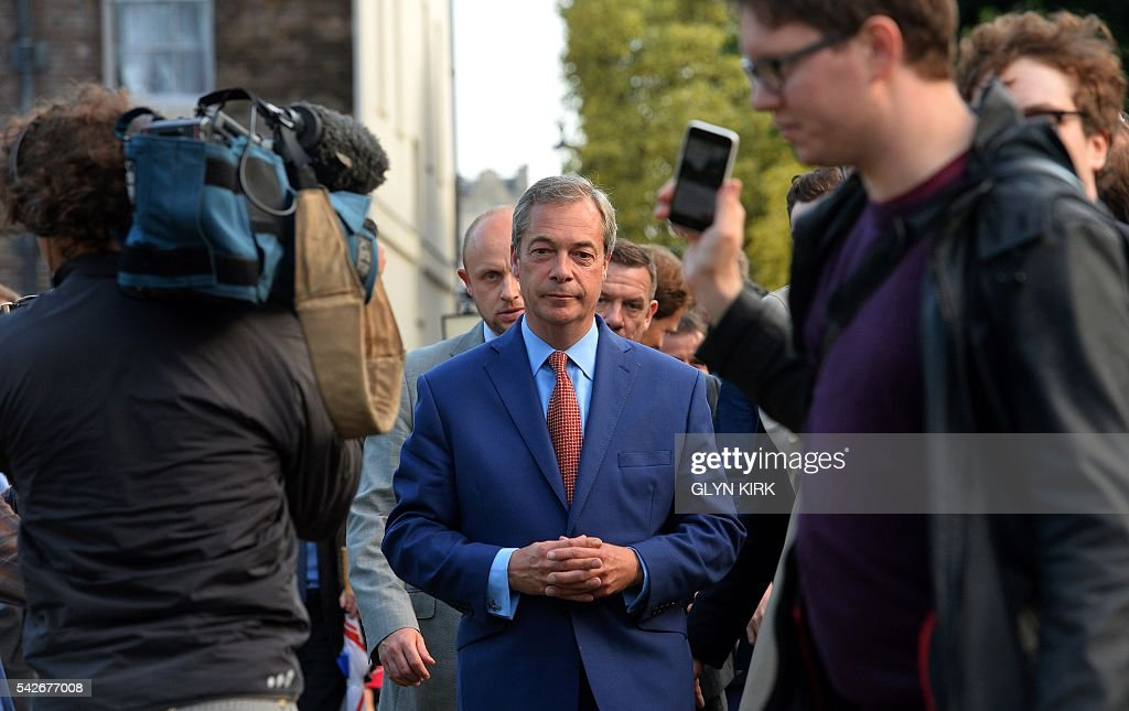 Leader of the United Kingdom Independence Party (UKIP), Nigel Farage (C) reacts as he leaves after speaking at a press conference near the Houses of Parliament in central London on June 24, 2016. Britain has voted to leave the European Union by 51.9 percent to 48.1 percent, final results from all 382 of Britain's local counting centres showed on Friday. / AFP / GLYN