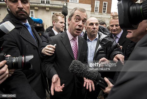 Leader of the United Kingdom Independence Party Nigel Farage speaks to members of the media after announcing his party's key election pledges in...