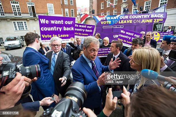 Leader of the United Kingdom Independence Party Nigel Farage speaks to media in front of a tour bus parked outside Europe House in Westminster on May...