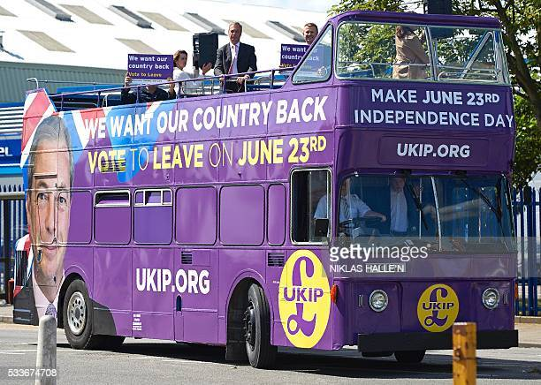 Leader of the United Kingdom Independence Party Nigel Farage stands atop his party's opentop bus as he arrives to campaign to leave the European...
