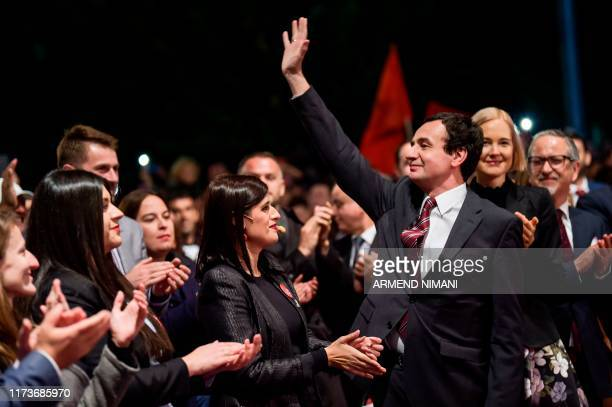 Leader of the Vetevendosje party and parliamentary elections candidate for Prime Minister Albin Kurti waves as he arrives for a rally in Pristina on...