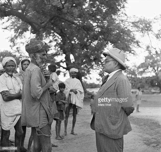 Leader of those formerly considered untouchable discusses a food shortage with a government official. Bengal Province, British India. | Location:...