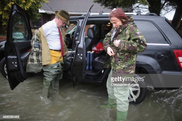 Leader of UKIP Nigel Farage puts n his waders as he tours flooded properties on February 11, 2014 in Chertsey, United Kingdom. The Environment Agency...