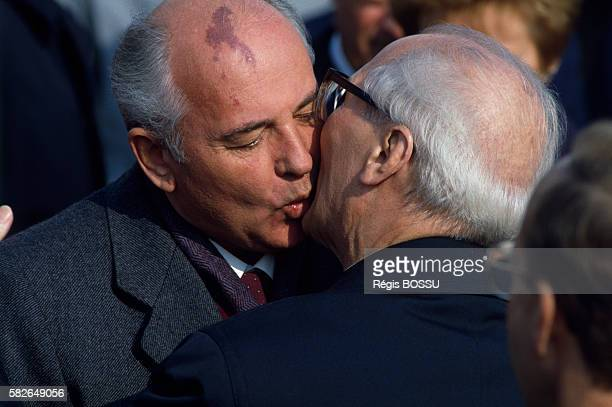 Leader of USSR Mikhail Gorbachev kissing East German President Erich Honecker during the 40th Anniversary of the German Democratic Republic