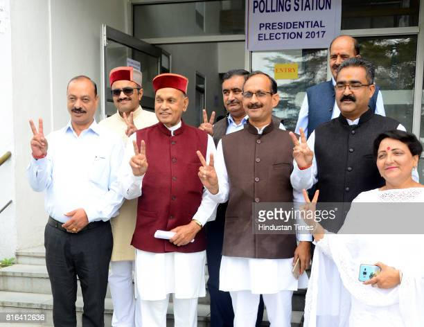 Leader opposition Prem Kumar Dhumal with BJP legislators comes out of the polling station after casting the vote for presidential seat at Himachal...
