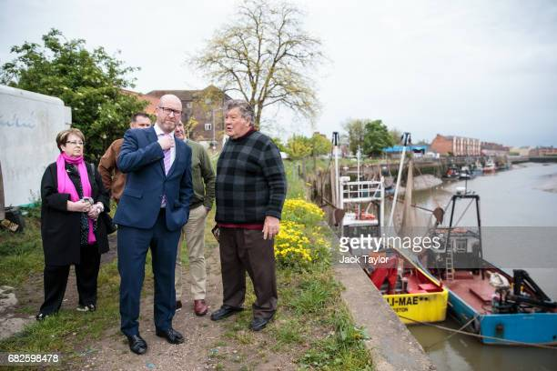 Leader Paul Nuttall chats with local fishermen at the quayside as he campaigns in Boston on May 12 2017 in Boston United Kingdom Mr Nuttall has...