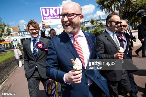 Leader Paul Nuttall holds an ice cream as he is joined by party activists and local candidate Paul Oakley as they campaign on May 20 2017 in...