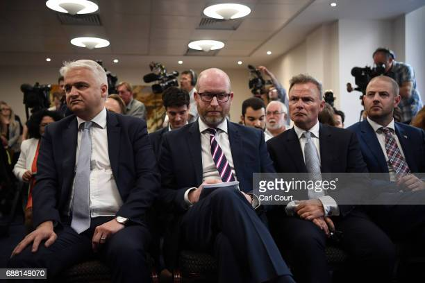 UKIP leader Paul Nuttall sits with MEP Patrick O'Flynn and deputy leader Peter Whittle during the launch of his party's manifesto ahead of the...