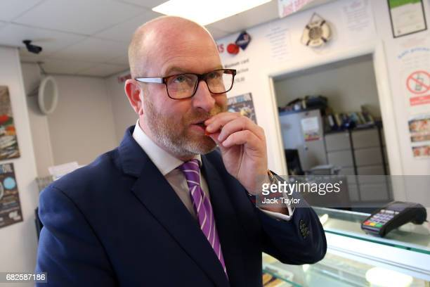 Leader Paul Nuttall tries a prawn as he visits a local fishmongers on May 13 2017 in Boston England UKIP Leader Paul Nuttall has chosen to stand in...