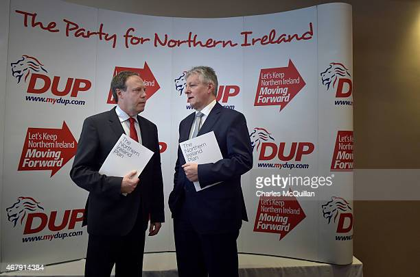 Leader Peter Robinson and deputy leader Nigel Dodds are pictured talking together at the Democratic Unionist Party Spring Conference on March 28,...