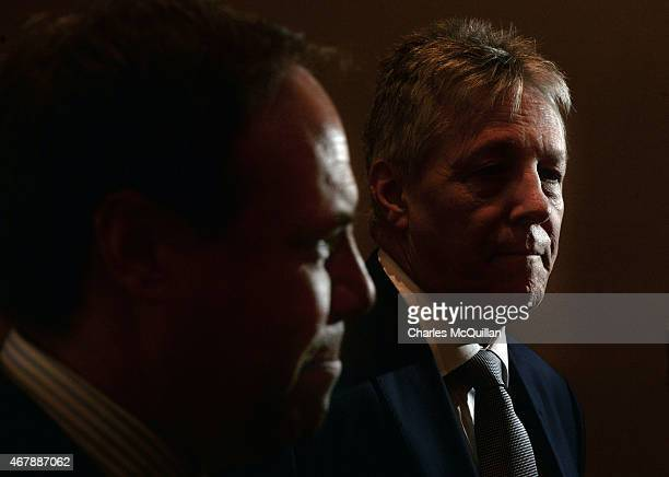 Leader Peter Robinson and deputy leader Nigel Dodds talk to the gathered media at the Democratic Unionist Party Spring Conference on March 28, 2015...