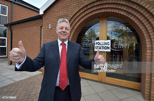 DUP leader Peter Robinson casts his vote on May 7 2015 in Belfast Northern Ireland The United Kingdom has gone to the polls to vote for a new...