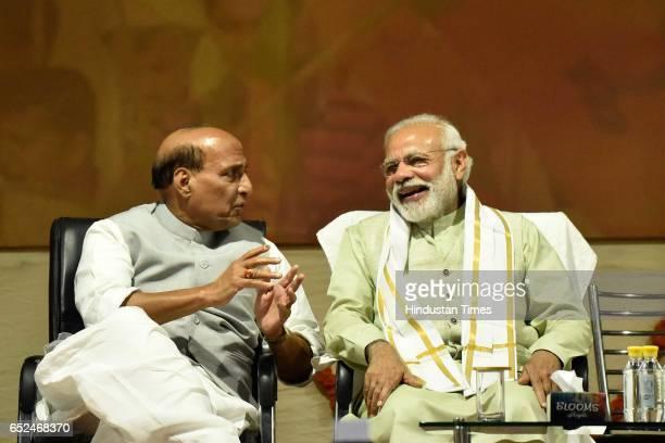BJP leader Rajnath Singh and Prime Minister Narendra Modi during the Holi Milan celebrations at Delhi BJP Office and celebrate party landslide...