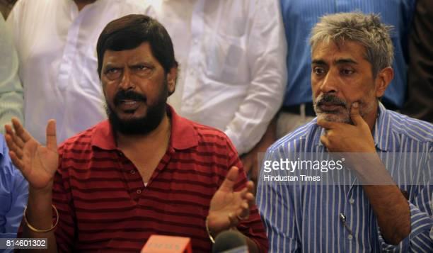 RPI leader Ramdas Athavale and Director Prakash Jha speak with media for his upcoming film Aarkhshan at Novetal Hotel Juhu on Thursday