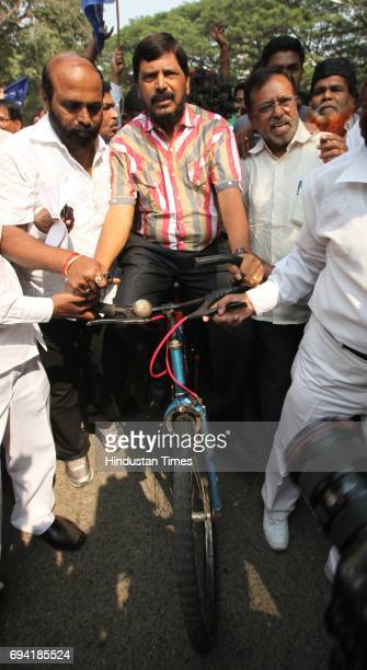 RPI leader Ramdas Athawale protests by riding a bicycle at Bandra against Petrol price hike