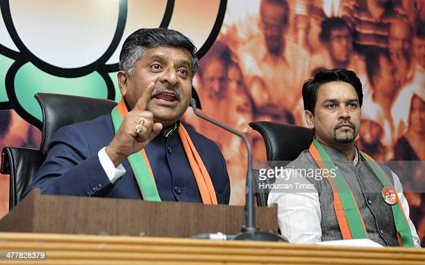 BJP leader Ravi Shankar Prasad and BJYM National President Anurag Singh Thakur address during an event in which youth leaders from different party...