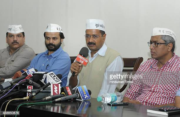 AAP leader Sanjay Singh Ashish Khaitan Arvind Kejriwal and Ashutosh addressing the press conference at Constitution Club on November 12 2014 in New...