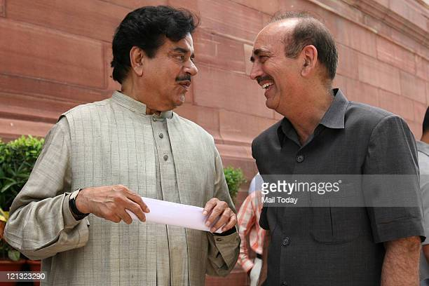 BJP leader Shatrughan Sinha and Congress leader Ghulam Nabi Azad share a light moment as they