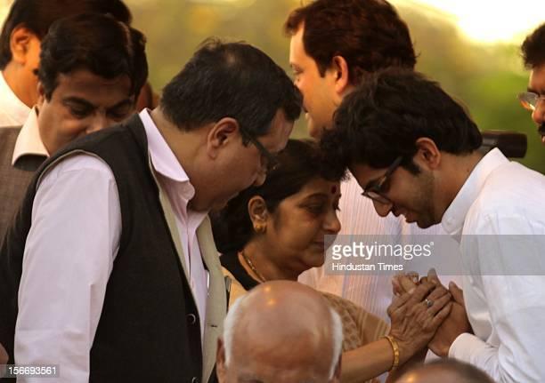 BJP leader Shushma Swaraj consoles Aditya Thackeray after paying her last tribute Bal Thakeray near Sena Bahvan Dadar West on November 18 2012 in...