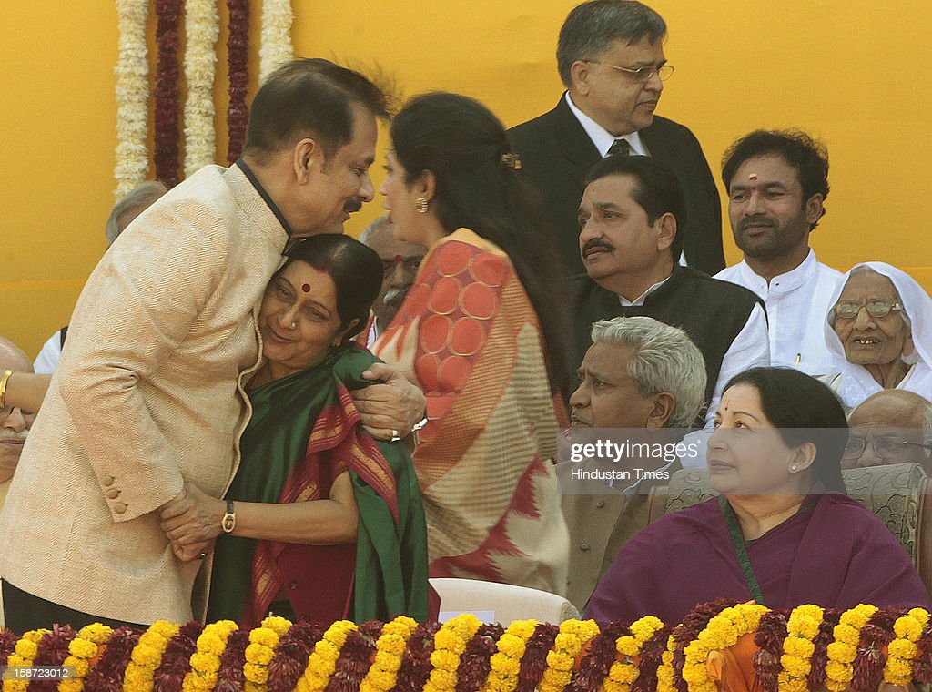 BJP leader Shushma Swaraj hugs Sahara Group chairman Subroto Roy as Tamil Nadu chief minister Jayalalita looks on during swearing ceremony of Gujarat CM Narendra Modi at Sardar Patel Stadium on December 26, 2012 in Ahmedabad, India. Narendra Modi sworn as Chief Minister of Gujarat for fourth successive term along with 16 ministers.