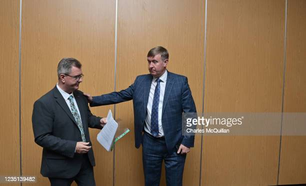 Leader Sir Jeffrey Donaldson interacts with party member Mervyn Storey after delivering a keynote speech at the La Mon House Hotel on September 9,...