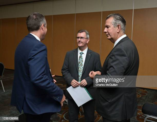 Leader Sir Jeffrey Donaldson talks to former party leader Edwin Poots and Northern Ireland First Minister Paul Givan after delivering a keynote...