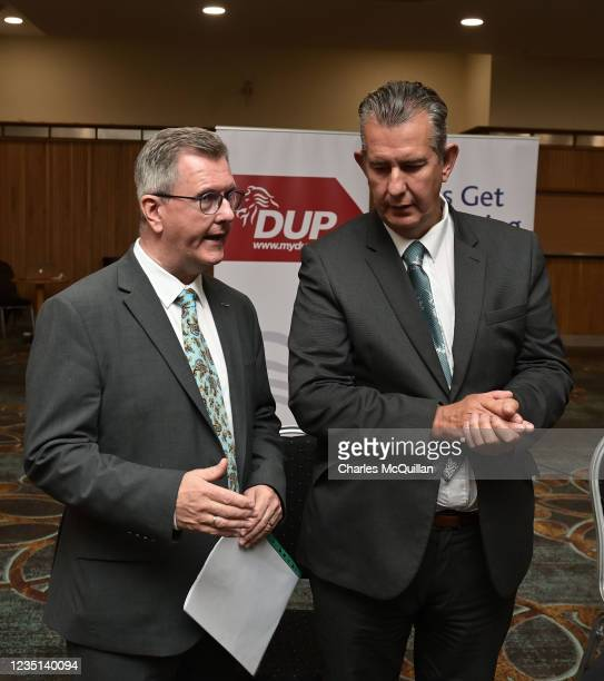 Leader Sir Jeffrey Donaldson talks to former party leader Edwin Poots after delivering a keynote speech at the La Mon House Hotel on September 9,...