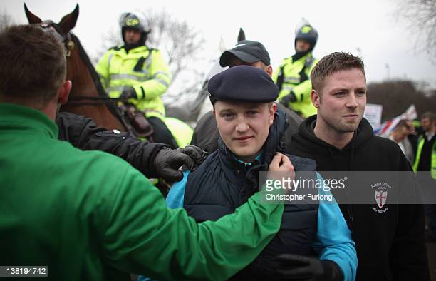EDL leader Stephen Lennon aka Tommy Robinson takes part in a demonstration through the streets of Leicester on February 4 2012 in Leicester England...