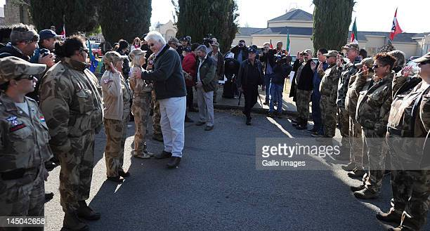 AWB leader Steyn van Ronge greets members outside the Ventersdorp magistrates court on May 22 2012 in Ventersdorp South Africa where Chris Mahlangu...