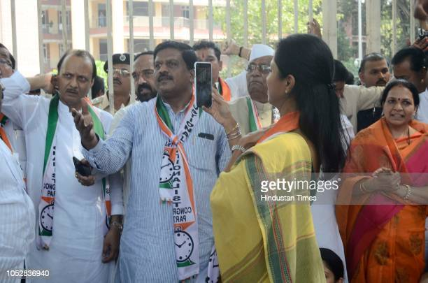 NCP leader Supriya Sule taking photo of Ajit Pawar during agitation against BJP government demanding declare drought at Council hall on October 22...
