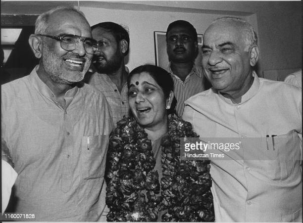 BJP leader Sushma Swaraj who has been elected as Leader of Delhi Assembly with Sahib Singh Verma and Madan Lal Khurana at BJP Office in New Delhi...