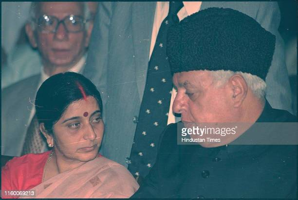 BJP leader Sushma Swaraj with NC leader Farooq Abdullah during New Chief Justice of India AS Anand being sworn in at Rashtrapati Bhavan in New Delhi...