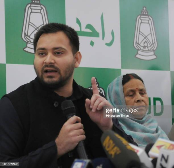 RJD leader Tejashwi Yadav with his mother and former Bihar Chief Minister Rabri Devi and party leaders speaking to media during a press conference...