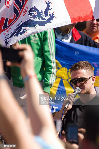 EDL Leader Tommy Robinson speaks to supporters of the farright English Defence League near Downing Street in central London on May 27 2013 as they...