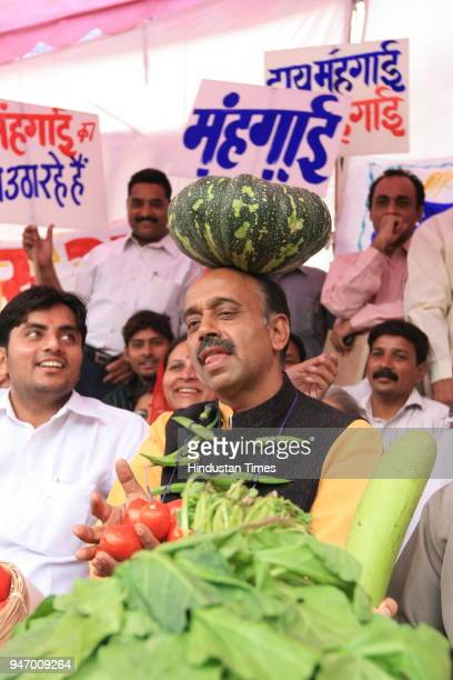 BJP leader Vijay Goel along with other BJP leaders protesting against 'price rise' at Town Hall in New Delhi