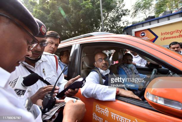 Leader Vijay Goel is fined by traffic police personnel as he arrives at Janpath from his residence, in an odd number car on the first day of the...