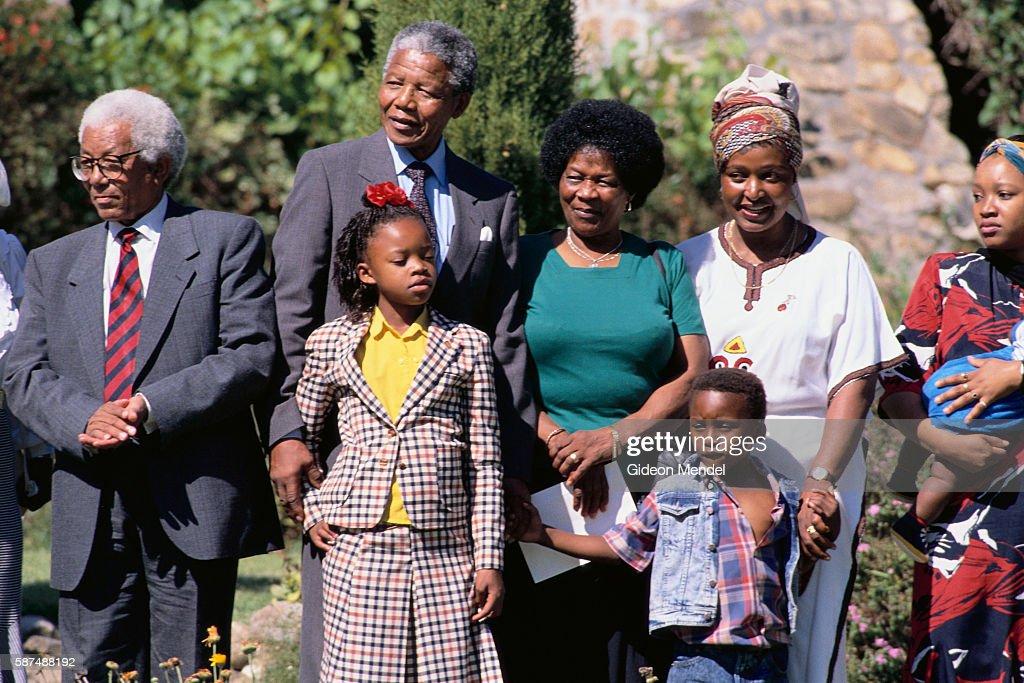 ANC leader Walter Sisulu stands beside Nelson Mandela, who ...