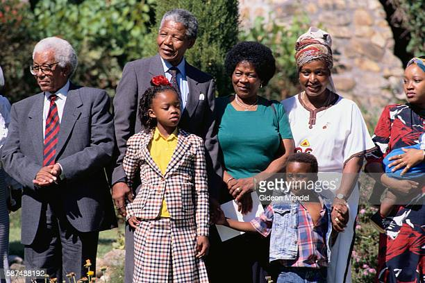 ANC leader Walter Sisulu stands beside Nelson Mandela who stands with some of his family including wife Winnie Mandela after his release from over 20...