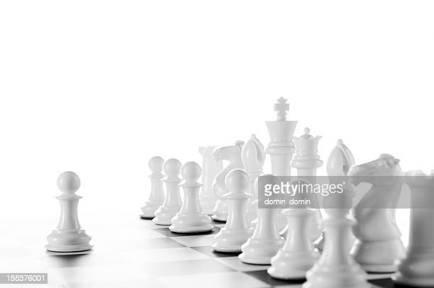 leader, white chess pawns on chess board, black and white - chess stock pictures, royalty-free photos & images