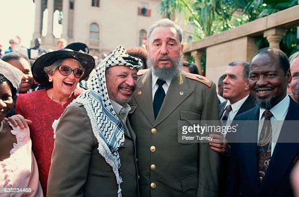PLO leader Yasser Arafat and Cuban president Fidel Castro pose together at Nelson Mandela's presidential inauguration ceremony
