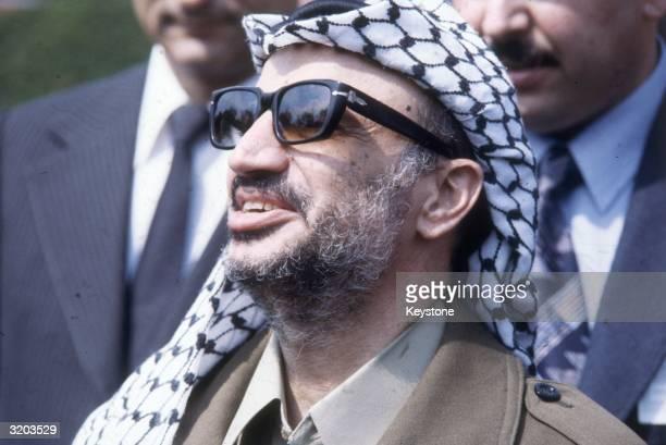 Leader Yasser Arafat at the funeral of Yugoslav President Tito .