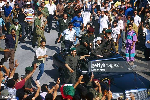 PLO leader Yasser Arafat's convoy passes through the village of Dar El Batah greeting hundreds of supporters The convoy is on its way to Rafah where...