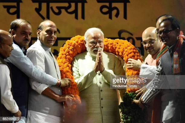 BJP leaders Amit Shah Venkaiah Naidu Shivraj Singh Chouhan and others greets Prime Minister Narendra Modi with a garland during the Holi Milan...