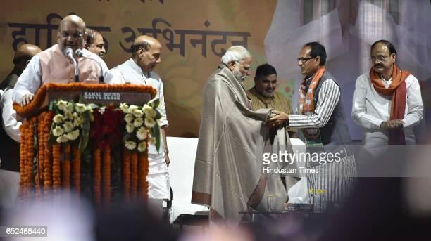 BJP leaders Amit Shah Venkaiah Naidu Shivraj Singh Chouhan Rajnath Singh and Prime Minister Narendra Modi during the celebrations at Delhi BJP Office...