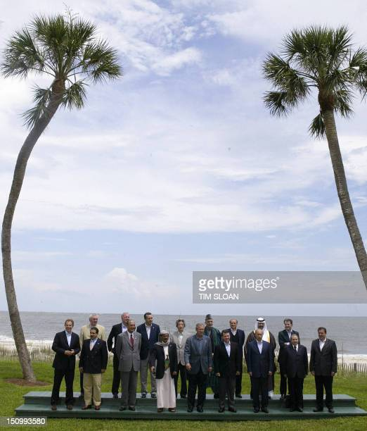 Leaders and guests of the Group of Eight Summit pose for a group picture 09 June 2004 on Sea Island in the southeastern coastal state of Georgia...